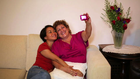 mother daughter taking own picture Footage