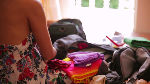 Preparing bag for travel Stock Video Footage