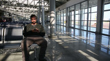 Using Mobile Phone At Airport stock footage