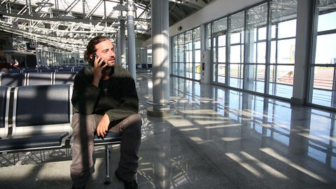 talking on phone at airport Stock Video Footage