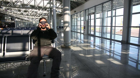 sleeping in airport with eye cover Stock Video Footage