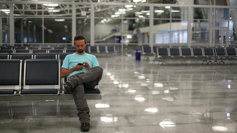using mobile phone at airport Footage