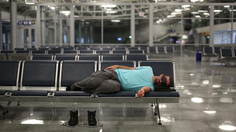sleeping in airport with eye cover Footage