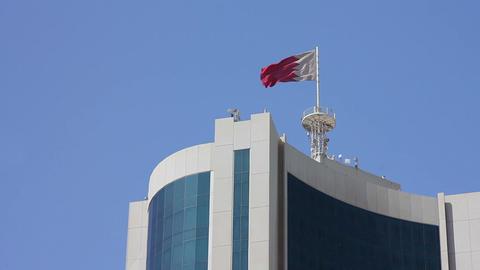 Bahrain flag on skyscraper Footage