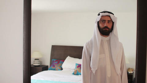 Arabic man dressing Stock Video Footage