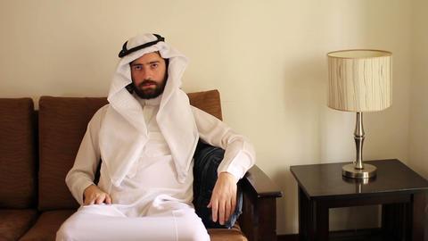 Saudi arabian man at home Stock Video Footage