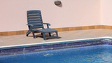 Sunbed At Swimming Pool stock footage