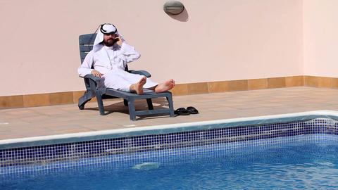 arabian talking phone at pool Footage