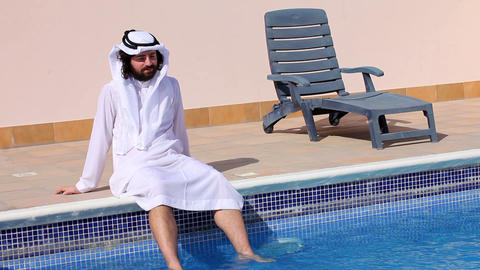Saudi arabian at swimming pool Footage
