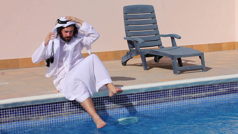 Saudi arabian at swimming pool Stock Video Footage