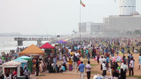 SRI LANKA - MARCH 2012: thousands of people at beach Stock Video Footage