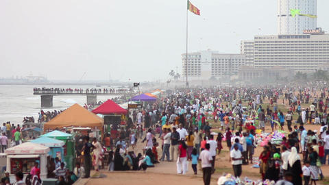 SRI LANKA - MARCH 2012: thousands of people at beach Footage