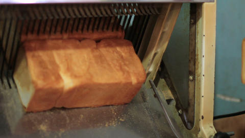 bread machine cutting into slices Stock Video Footage