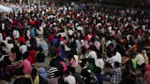 MALAYSIA - 2012: Crowded people watching tv in kuala lumpur Footage