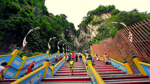 KUALA LUMPUR - MARCH 2012: people climbing batu caves steps Footage