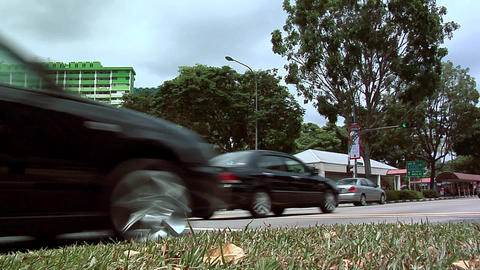 Traffic on Victoria Street and Crossing Rochor Road at Bugis Village, Singapore Footage