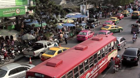 Afternoon Traffic besides the Chatuchak Market on Kamphaeng Phet, Bangkok Footage