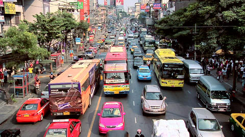Afternoon Traffic on Ratchawithi Road at Victory Monument, Bangkok Live Action