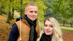 happy couple smiles - young model couple in love - autumn park (nature) - closeu Footage