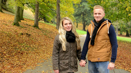young model couple in love - autumn park(nature) - couple holding hands - happy  Footage