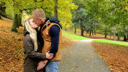 young model happy couple in love - couple kiss - autumn park (nature) Footage