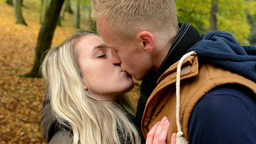 young model happy couple in love - couple kiss - autumn park (nature) - closeup Footage