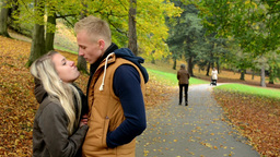 young model couple in love plays - autumn park (nature) - happy couple kiss and  Footage