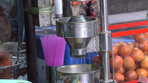 The squeezing of Fresh Thai Orange Juice from a Sidewalk…, Live Action