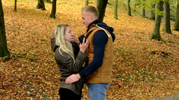 young model couple in love - happy couple in autumn park(nature) - woman on phon Footage