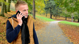 man on the phone (man calling by smartphone) - man smiles (happy) - man in autum Footage
