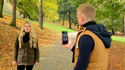 young model couple in love - autumn park(nature) - man photographing woman with  Footage