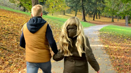 young model couple in love - autumn park(nature) - couple (man and woman) runnin Footage