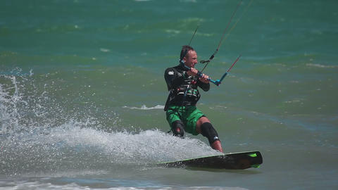 Kiteboarder surfing waves with kiteboard Footage