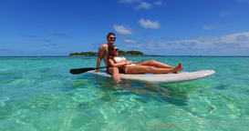 v11304 two 2 people romantic young people couple paddleboard surfboard with Footage