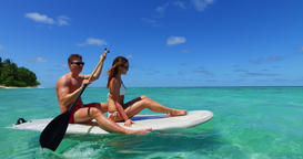 v11381 two 2 people romantic young people couple paddleboard surfboard with Footage