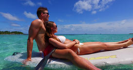 v11306 two 2 people romantic young people couple paddleboard surfboard with Footage