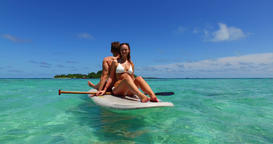 v11323 two 2 people romantic young people couple paddleboard surfboard with Footage