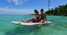 v11309 two 2 people romantic young people couple paddleboard surfboard with Footage