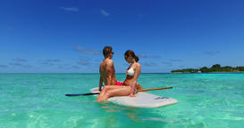 v11365 two 2 people romantic young people couple paddleboard surfboard with Footage