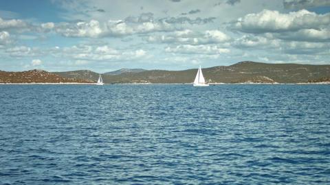 Mountainous coastline. Yachts floating on the sea Footage