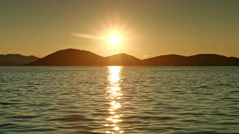 Sun shining above sea. Sunset Footage