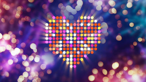 Colorful shiny heart shape and fireworks on background loop Animation