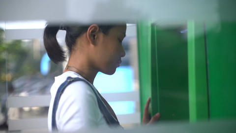 Young Asian Woman using ATM machine Footage
