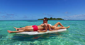 v11344 two 2 people romantic young people couple paddleboard surfboard with Footage