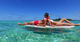 v11345 two 2 people romantic young people couple paddleboard surfboard with Footage