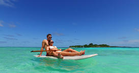 v11375 two 2 people romantic young people couple paddleboard surfboard with Footage