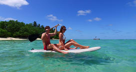 v11319 two 2 people romantic young people couple paddleboard surfboard with Live Action