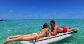 v11353 two 2 people romantic young people couple paddleboard surfboard with Live Action