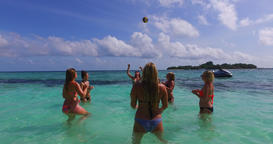 v12684 group of young beautiful girls playing beach ball and sunbathing in aqua Live Action