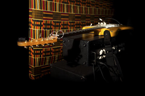 Electric Guitar Resting On Amplifire In Music Studio Photo
